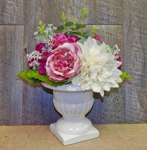 Dahlia bouquet in urn centerpiece